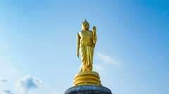 Buddha gold and clouds sky daytime Stock Footage