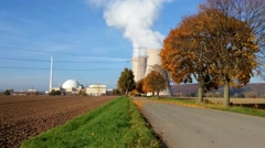 Nuclear power plant on the sky background - stock footage