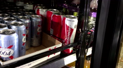 Shoppers buying Budweiser beer Stock Footage