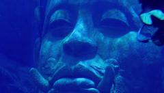 Stock Video Footage of Diver Swims Past Ancient Statue In The Sea