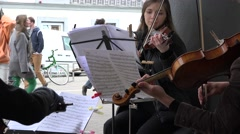 Undefined street musician play with violin and note. 4K Stock Footage