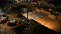 Workers Mixed Concrete On The Construction Site Stock Footage
