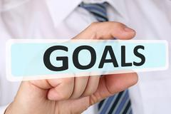 Businessman business concept with goal goals to success and growth - stock photo