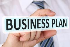 Stock Photo of Businessman business plan concept for start up company founding