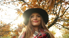 Woman throwing leaves in autumn fall forest 4K. - stock footage