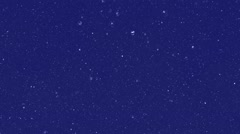 White snow falling from the dark night sky Stock Footage