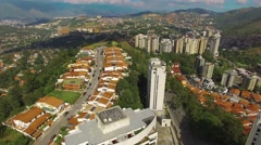 Aerial view overflight of a residential district on a tropical capital city - stock footage
