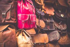 Stock Photo of Moroccan leather goods bags in a row at outdoor market