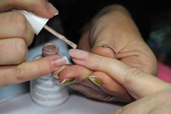 female hands painted nails new layer - stock photo