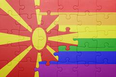 Stock Photo of puzzle with the national flag of macedonia and gay flag