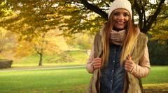 Woman relaxing enjoying autumn fall park 4K. - stock footage