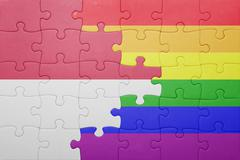 puzzle with the national flag of indonesia and gay flag - stock photo