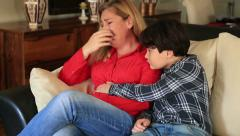 Sad woman with son - stock footage