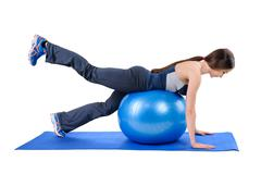 Fitness Stability Ball Glute Kickback - stock photo