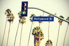 Cross processed Hollywood sign and traffic lights with palm trees, LA. Stock Photos