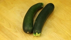 Zucchini on a wooden boards background - stock footage