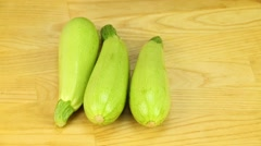 Courgettes  on a wooden boards background Stock Footage