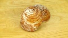 Bun with cinnamon and powdered sugar - stock footage