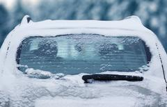 Winter frozen back car window, texture freezing ice glass background Stock Photos