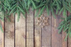 Stock Photo of Background from boards with fir-tree branches from above