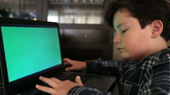 Young boy with green screen laptop monior 2 - stock footage