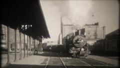 2728 - vintage steam engine train pulls into station - vintage film home movie Stock Footage
