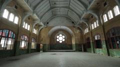 Guy exploring an abandoned sanatorium hall Stock Footage