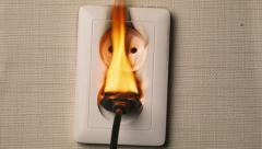 Fire in European style  wall socket. Concept: house insurance, the insured event Stock Footage