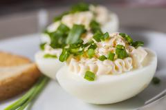 Boiled eggs with mayonnaise and sliced chive Stock Photos