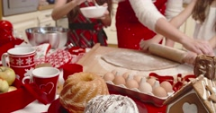 Family preparing christmas gingerbread in the kitchen Stock Footage