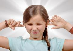Girl covering her ears,to say stop making loud noise giving me headache Stock Photos