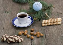 fir-tree branch, coffee, sweets, hazelnuts still life - stock photo