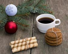 Coffee, two linking of cookies and a coniferous branch with scenery Stock Photos