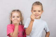 Six year old girl showing her teeth, four-year girl afraid of toothache Stock Photos