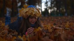 Girl is looking at leaves - stock footage