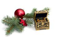 Coniferous branch with New Year's scenery and an open casket with nuts Stock Photos