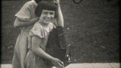 2730 - girl with classic 4X5 waist level view camera - vintage film home movie Stock Footage