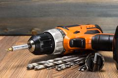 battery powered drill and drill bits - stock photo