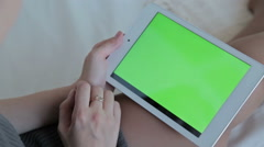 Woman watch on green screen tablet computer closeup. The concept of buying - stock footage