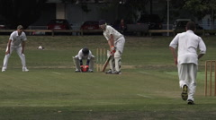 Cricket bowler bowling to a batsman Stock Footage