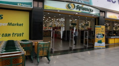 Exit from one of the Spinneys supermarket chain is in the Senzo Mall, Egypt Stock Footage