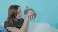 Woman holding little cute rabbit Stock Footage