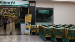 Entrance of one of the Spinneys supermarket chain is in the Senzo Shopping Mall Stock Footage