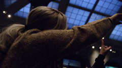 Mother and son pointing at blue whale on ceiling at Museum of Natural History 4K Stock Footage