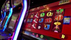Close up woman playing slot machine - stock footage