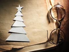 Christmas tree cut out from paper and glasses - stock photo