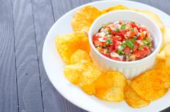 Stock Photo of nachos with salsa