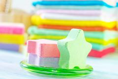Assortment of soap and towels - stock photo