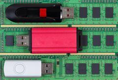 Close up of modern data backup thumb drives and memory chips Stock Photos