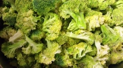 Lots of green Broccoli, Brassica oleracea, at a restaurant Stock Footage